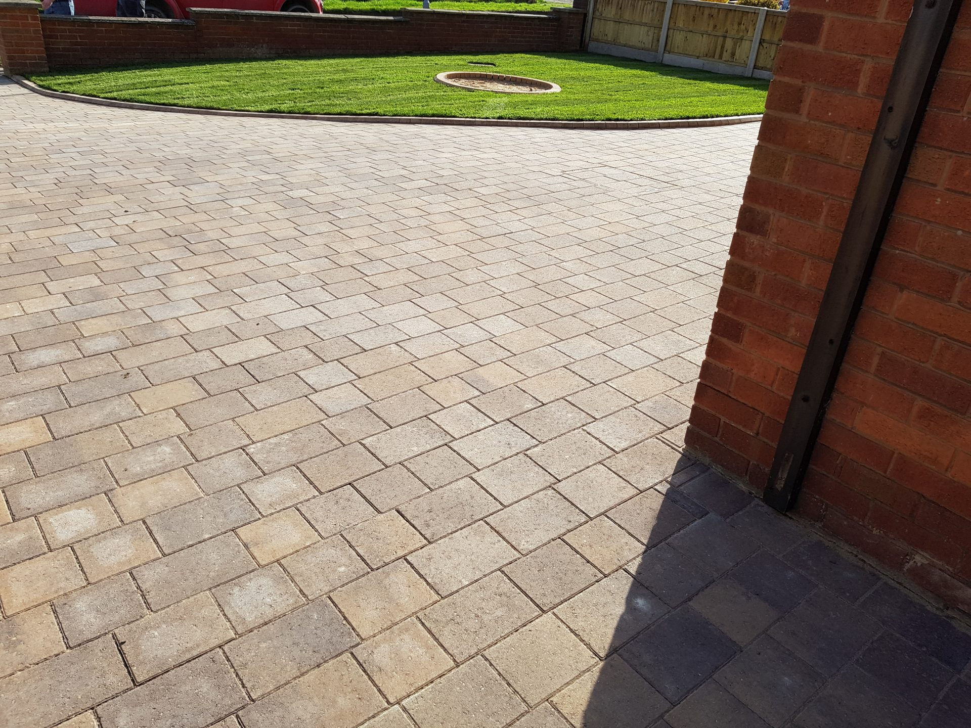 Block paved driveway and lawn area
