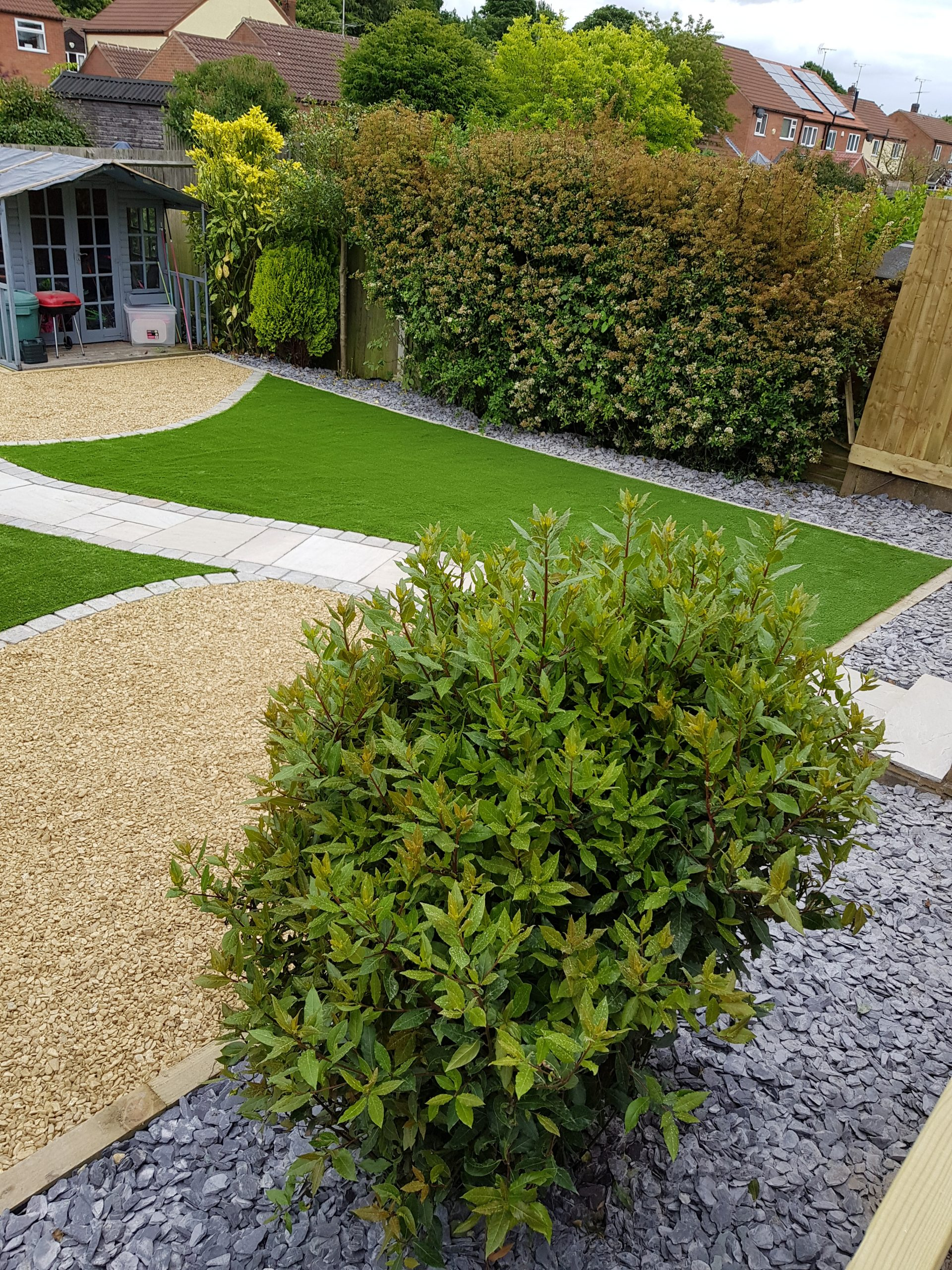 Garden make over with artificial grass, slate areas and pathway