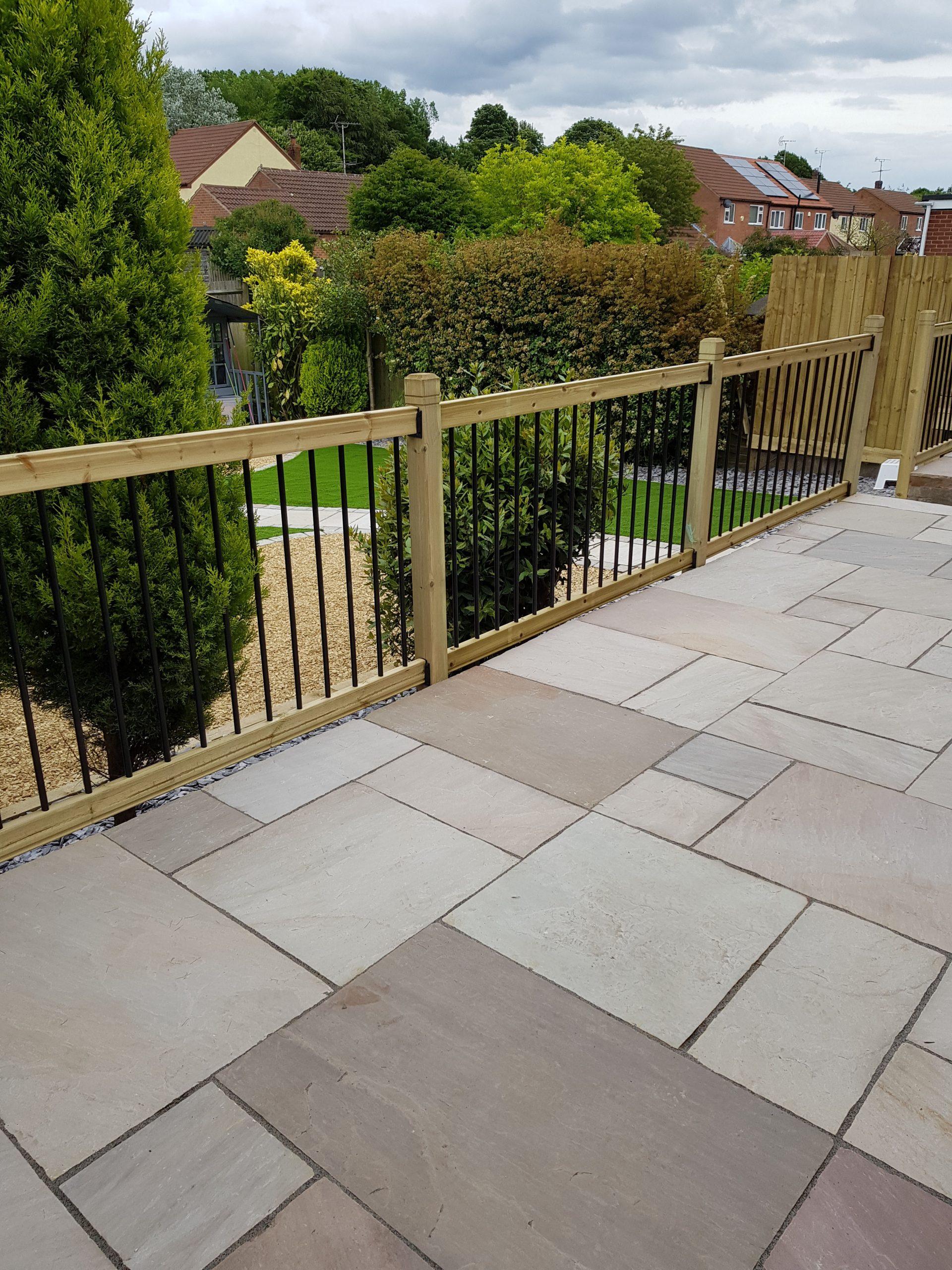 Raised patio seating area with railings