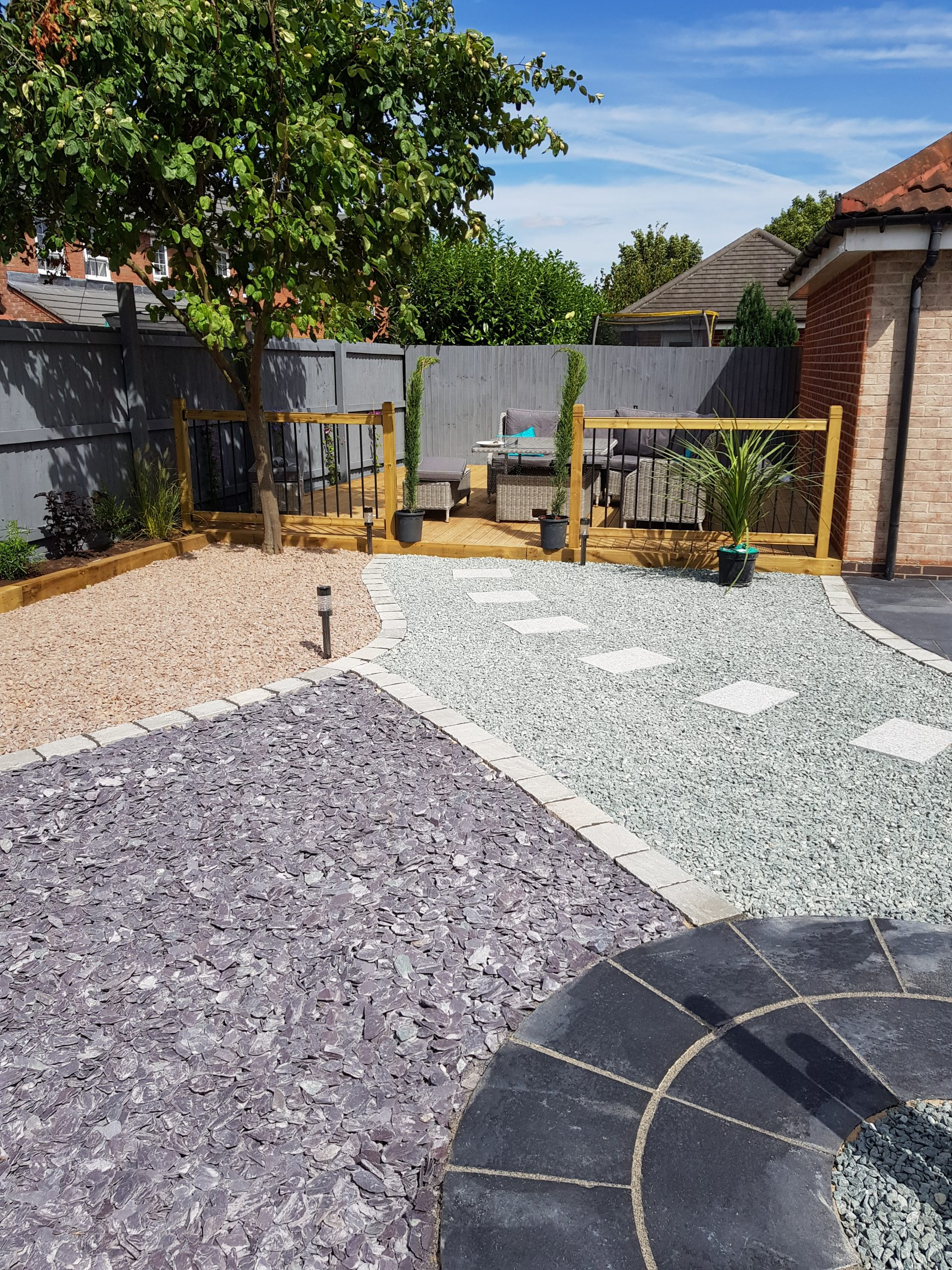 Garden transformation Newark, grey and plum slate, patio, raised wooden sleeper borders