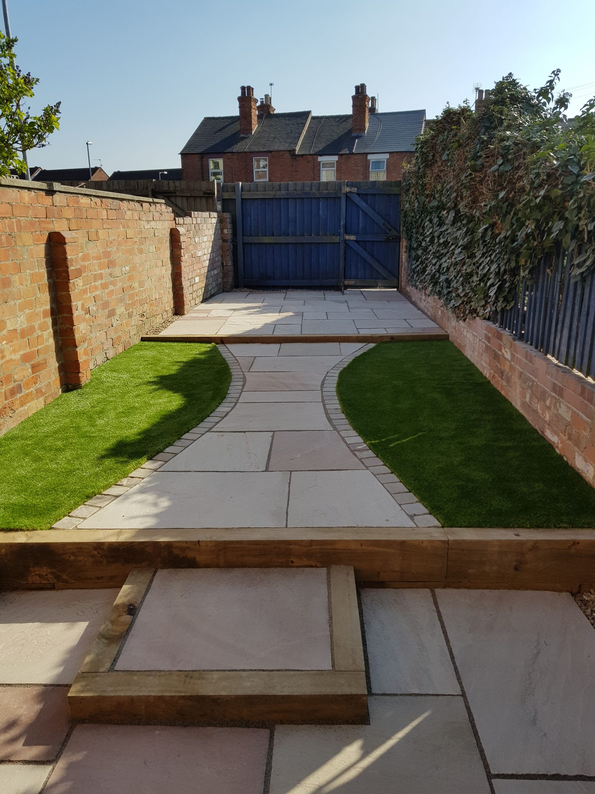 Whole Garden makeover paving slabs and curved lawn area