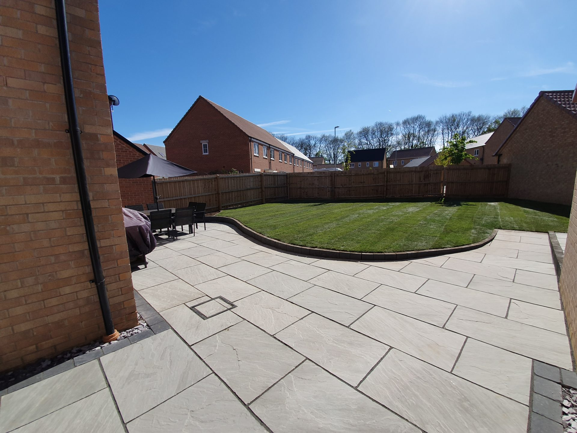 raised lawn curved large patio seating area