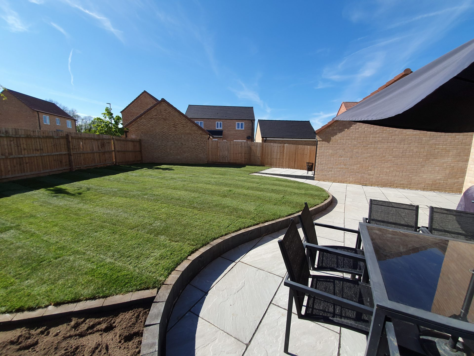 raised lawn curved patio seating area