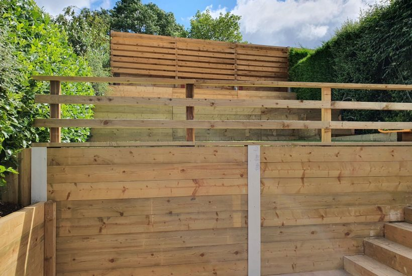 Tiered garden retainer wall, cobbles wooden steps and fencing